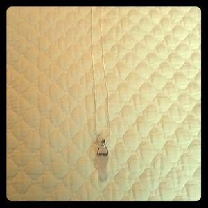 Jewelry - A rose quartz pendant necklace